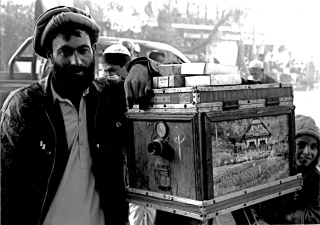 Photographer in a street in Kabul, Afghanistan