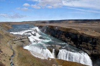 Gullfoss: a two-tiered waterfall that drops 32 metres into a narrow canyon 70 meters deep and 2,( kms long.