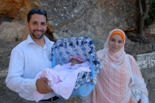 Proud couple with first-born child in Lybia